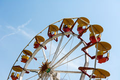 People Riding Giant Ferris Wheel Stock Image