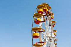 People Riding Giant Ferris Wheel Stock Photography