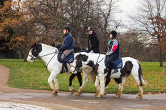People riding horses in Hyde Park. London, United Kingdom Stock Photography