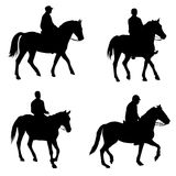 People riding horses silhouettes Stock Photography