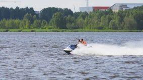 Riders on jet ski on lake. royalty free stock images