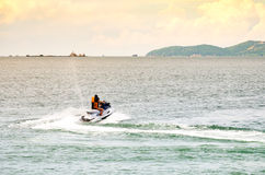 People riding jet ski in the sea Royalty Free Stock Photo