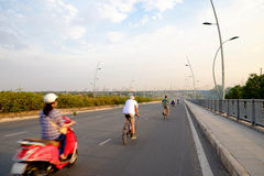 People riding Moto cycle on bridge in VietNam Stock Photo