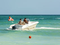 People Riding Motor Boat Royalty Free Stock Image