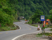 People riding motorbikes on rural road in Lang Son, Vietnam Stock Photography