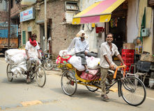 People riding rickshaws on street in Amritsar, India Royalty Free Stock Images