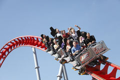 People riding roller coaster. Ride, fun on family day out at the funfair Drayton Manor theme park, England Stock Photo