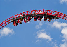 People riding roller coaster Royalty Free Stock Photo
