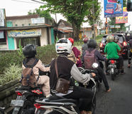 People riding scooters on street in Jogja, Indonesia Royalty Free Stock Photos