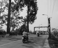 People riding scooters on street in Sadek, Vietnam Stock Image