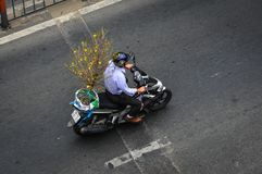 People riding scooters on street in Saigon