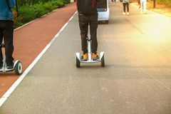 Man riding on a Segway in the park on the Sunset. royalty free stock images