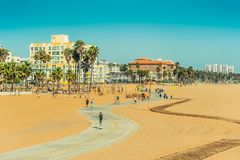 Los Angeles/California/USA - 07.22.2013: People riding on the skate board and bike over bicycle track. Stock Image