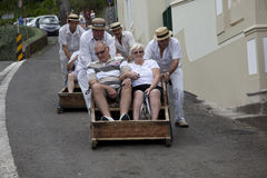 People riding sled in madeira royalty free stock photography