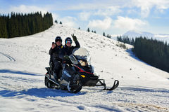 People riding snowmobile Royalty Free Stock Images