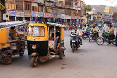 People riding tuk-tuks and motobikes at Sadar Market, Jodhpur, I Royalty Free Stock Photos