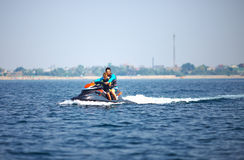 People riding on watercraft. summer fun Stock Photos