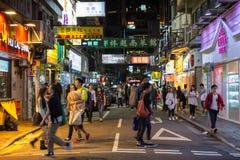 People at a road in Kowloon, Hong Kong at dark Royalty Free Stock Images
