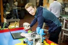 People in the robotics classroom Stock Image