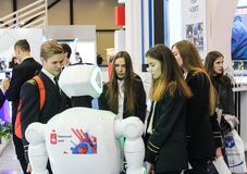 A group of students and a robot. Royalty Free Stock Photo