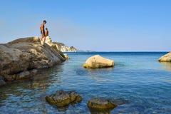 People on the rock. People on the rock in sea. Marathias beach, Zakynthos Island, Greece stock images