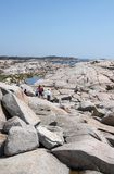 People on the rocks, Peggy's Cove Stock Photo