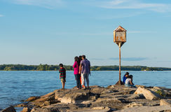 People on a rocky lake shore Royalty Free Stock Images