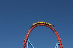 People in roller coaster. At amusement park Royalty Free Stock Images