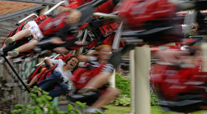 People on the roller coaster. People having fun riding on a roller coaster royalty free stock photo