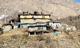 People on a roof. A group of people gathered together on a roof in village in kurdistan stock image