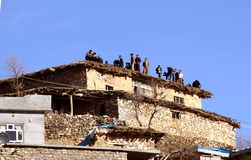 People on a roof. A group of people gathered together on a roof in village in kurdistan royalty free stock image