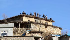 People on a roof. A group of people gathered together on a roof in village in kurdistan royalty free stock photography