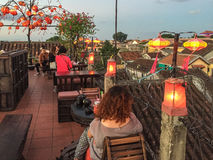 People at the roof top coffee shop in Hoi an, Vietnam Stock Image