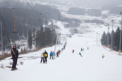 People on rope tow on ski resort. KUROVO, DMITROVSKY DISTRICT, RUSSIA – CIRCA JANUARY 2012: Skiers on ski rope on ski resort Sorochany in Moscow Region on Royalty Free Stock Photo