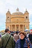 People at Rotunda Dome church of Mosta Malta. Mosta, Malta - April 6, 2014: People at Rotunda Dome church of Mosta, Malta Stock Photo