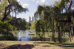 People row in boats on new york city central park pond near boat Royalty Free Stock Photography