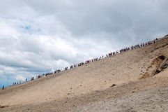 People in a row climb mountains Royalty Free Stock Photography