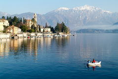 People on a rowing boat at the coast of lake Como Stock Photography