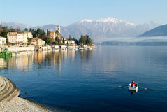 People on a rowing boat at the coast of lake Como Royalty Free Stock Photo