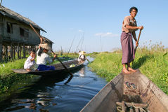 People on rowing a boat at the village of Maing Thauk Royalty Free Stock Image