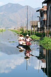 People on rowing a boat at the village of Maing Thauk Royalty Free Stock Photography