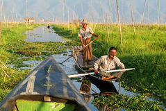 People on rowing a boat at the village of Maing Thauk Royalty Free Stock Photo