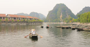 People rowing boats for carrying tourists in Tam Coc Royalty Free Stock Photo