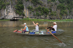 People rowing boats for carrying tourists in Tam Coc Stock Photography
