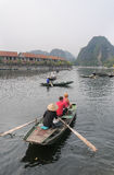 People rowing boats for carrying tourists in Tam Coc Royalty Free Stock Images
