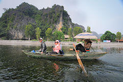 People rowing boats for carrying tourists in Tam Coc Stock Images