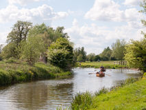 People rowing boats down the river stour in dedham essex uk engl Royalty Free Stock Photography