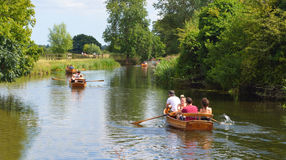 People rowing boats on the river Stour Stock Image