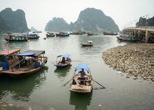 People rowing boats on sea in Halong, Vietnam.  Stock Image