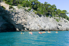 People rowing on the coast of Gargano in Puglia, Italy Royalty Free Stock Image